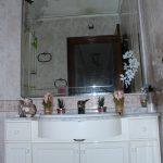 Bathroom with wash basin, bath / shower, and toilet