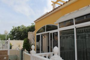 Two bedroom, one bathroom quad bungalow with sunny outside space for sale in Punta Prima